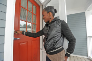 Courtney Morris, puts the keys in the lock of her new aprt at Carpenters Glenn, in East Taunton Gazette photo by Mike Gay